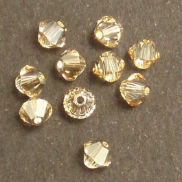 Swarovski® 4mm Golden Shadow Bicone Xilion Cut Beads (Pack of 10)