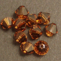 Swarovski® 4mm Smoked Topaz Bicone Xilion Cut Beads (Pack of 10)